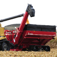 Double Auger Grain Cart Catching in Field