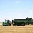 Parker 1354 Double Auger Grain Cart Pulling Away From Combine